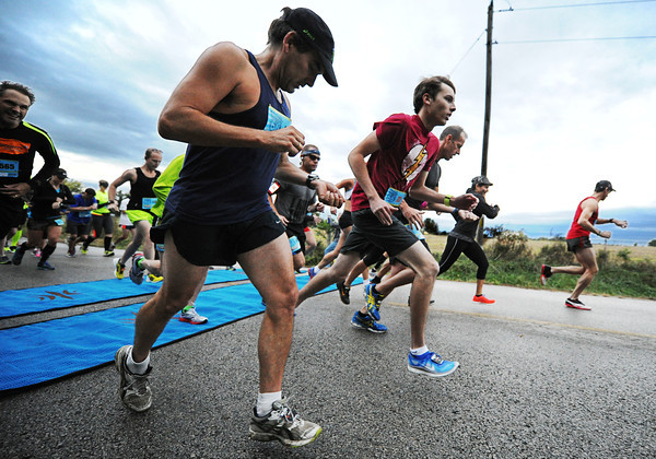 Half-marathon contestants start the race near Baxter Springs, Kan., Sunday morning, Oct. 13, 2013.<br /> Globe | T. Rob Brown