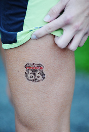 Kelly O'Toole of Springdale, Ark., and formerly of Joplin, hikes her shorts up a bit to show some Route 66 love--a Mother Road temporary tattoo on her leg--Sunday morning, Oct. 13, 2013, near the starting line near Baxter Springs, Kan.<br /> Globe | T. Rob Brown
