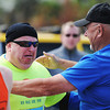 A well of emotion on finishing the half-marathon, Robert Suman gets a hug from Gary Ice, both of Miami, Okla., Sunday morning, Oct. 13, 2013, at the finish line for the Mother Road Marathon at the Joplin Athletic Complex. This was Suman's first half-marathon. Ice, who is the full marathon road manager, has been helping coach Suman and said the participant has made significant progress in his running and he was happy for him.<br /> Globe | T. Rob Brown