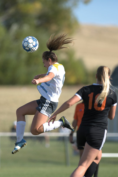 Matthew Gaston | The Sheridan Press<br>Sheridan College's Chelsea Thornburgh (9) heads the ball to a teammate at Maier Field during play against Central Community College Friday, Oct. 4, 2019.