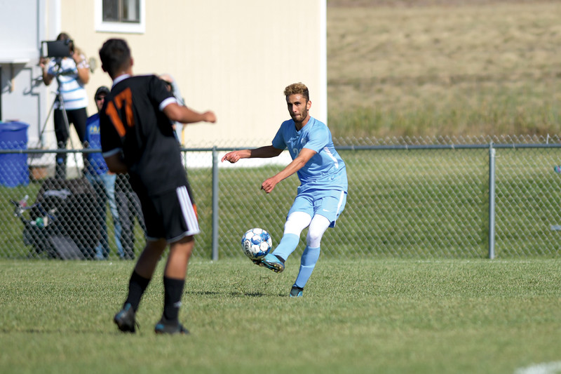 Matthew Gaston | The Sheridan Press<br>Sheridan College's Bryce Taylor (23) crosses the ball to Carter Wells (13) at Maier Field Friday, Oct. 4, 2019.