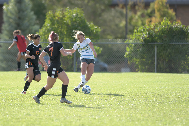 Matthew Gaston | The Sheridan Press<br>Sheridan College's Baylee Hamlin (21) fires off a shot on goal against Central Community College Friday, Oct. 4, 2019.