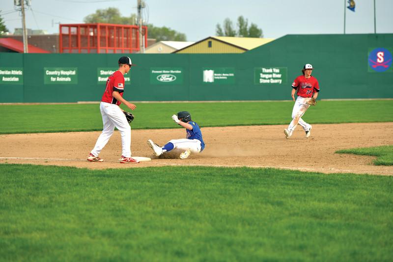 Matthew Gaston | The Sheridan Press<br>Sheridan's Dawson Lee (26) slides into third after a base hit from Anthony Carlson Friday, May 31, 2019.