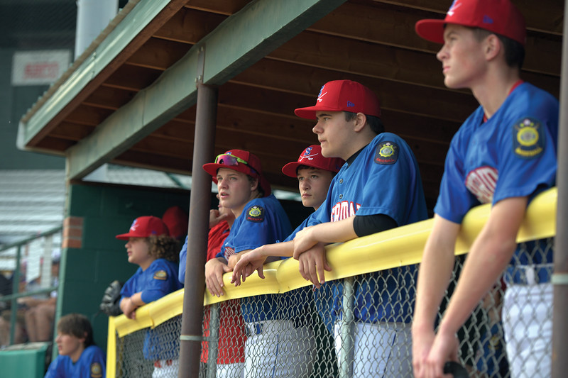 Matthew Gaston | The Sheridan Press<br>The Sheridan Jets stand at the front of the dugout to support their batter Friday, May 31, 2019.