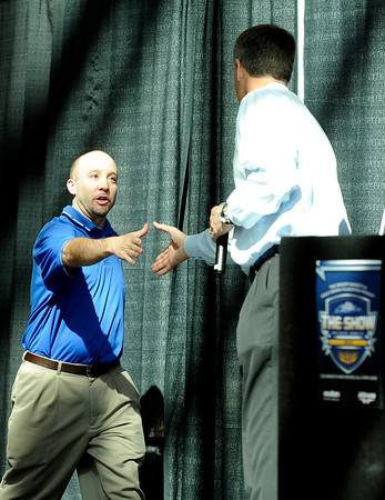 "Centaurus High School girls basketball coach Jeff Jackson shakes hands with Bill Hanzlik during The Show on Monday, March 5, at the Pepsi Center in Denver. The Show is a press conference announcing the high school players that were selected for the 2012 Colorado State All Star game. For video interviews with the All Star players from Boulder County go to  <a href=""http://www.dailycamera.com"">http://www.dailycamera.com</a><br /> Jeremy Papasso/ Camera"