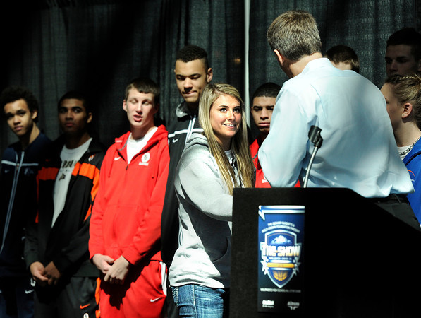 "Monarch High School's Ashton Davis, center, shakes hands with Bill Hanzlik while being introduced during The Show on Monday, March 5, at the Pepsi Center in Denver. The Show is a press conference that announces the players for the Colorado State All-Star game. For video interviews with the All Star players from Boulder County go to  <a href=""http://www.dailycamera.com"">http://www.dailycamera.com</a><br /> Jeremy Papasso/ Camera"