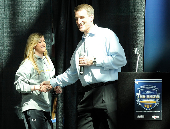 """Holy Family High School's Stephanie Giltner shakes hands with Bill Hanzlik during The Show on Monday, March 5, at the Pepsi Center in Denver. The Show is a press conference announcing the high school players that were selected for the 2012 Colorado State All Star game. For video interviews with the All Star players from Boulder County go to  <a href=""""http://www.dailycamera.com"""">http://www.dailycamera.com</a><br /> Jeremy Papasso/ Camera"""