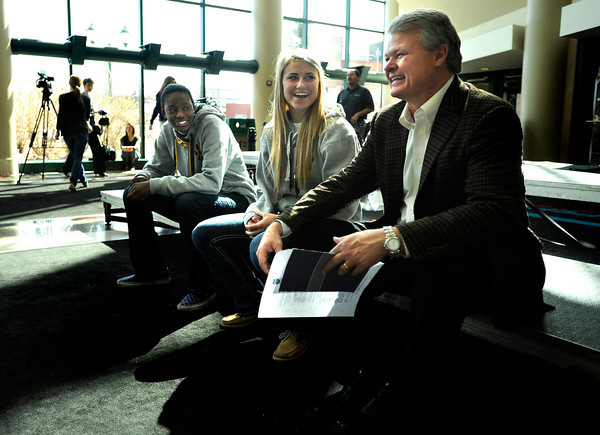 "Monarch High School's Alexus Johnson, left, and Ashton Davis, center, laugh while talking with Jerry Huggins, father of Heritage High School's Lauren Huggins, during The Show on Monday, March 5, at the Pepsi Center in Denver. The Show is a press conference announcing the high school players that were selected for the 2012 Colorado State All Star game. For video interviews with the All Star players from Boulder County go to  <a href=""http://www.dailycamera.com"">http://www.dailycamera.com</a><br /> Jeremy Papasso/ Camera"