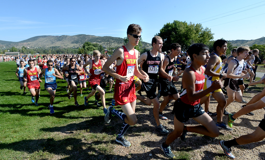 . LYONS, CO: September 8:  Alexander Bauman, center, of Skyline, during the St Vrain Invitational Cross Country Meet. (photo by Cliff Grassmick/Staff Photographer).