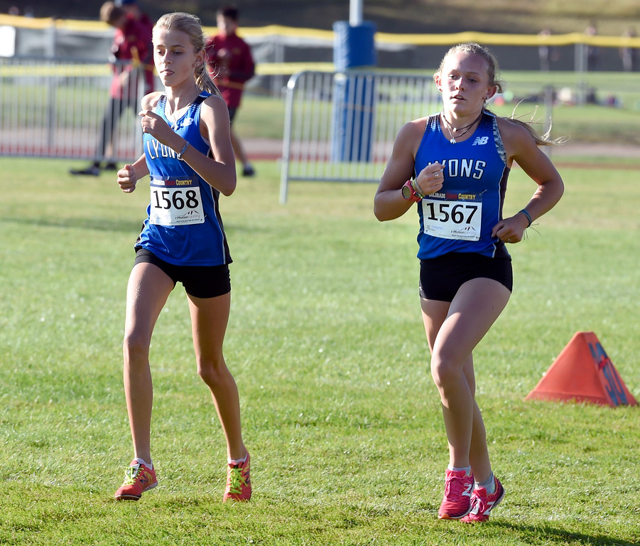 . LYONS, CO: September 8:  Quin Gregg, left, of Lyons, was 5th, and Katie Fankhouser, of Lyons was 4th in the 2A/3A during the St Vrain Invitational Cross Country Meet. (photo by Cliff Grassmick/Staff Photographer).