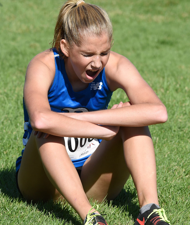 . LYONS, CO: September 8:  Sydney Swanker, of Broomfield, is feeling the pain after her win in 4A/5A girls during the St Vrain Invitational Cross Country Meet. (photo by Cliff Grassmick/Staff Photographer).