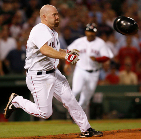 BOSTON, MA, Aug. 11, 2009: Boston Red Sox batter Kevin Youkilis (left) throws his batting helmet as he charges the mound after being hit with a baseball thrown by Detroit Tigers pitcher Chris Porcello in the second inning. (Brita Meng Outzen/Boston Red Sox)