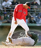March 27, 2006, Fort Myers, Fla.: Boston Red Sox pitcher Julian Tavarez, top, stands on the right arm of  Tampa Bay Devil Rays base runner Joey Gathright after he slid into Tavarez while trying to score on a hit by Julio Lugo in the eighth inning of their spring training baseball game. Both benches cleared after the incident. (AP Photo/Brita Meng Outzen)