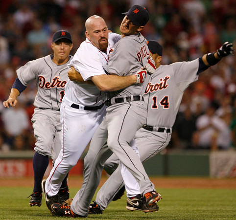 BOSTON, MA, Aug. 11, 2009: Detroit Tigers pitcher Rick Porcello (second from right) pulls Boston Red Sox batter Kevin Youkilis (second from left) down to the ground after Youkilis charged him as a result of being hit with a pitch in the second inning as Tigers third baseman Brandon Inge (left) and second baseman Carlos Guillen rush to help Porcello. (Brita Meng Outzen/Boston Red Sox)