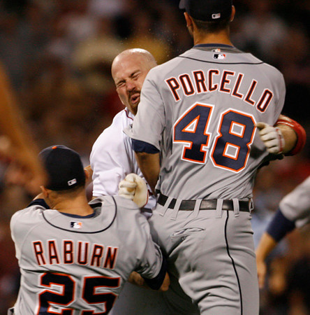 BOSTON, MA, Aug. 11, 2009: Detroit Tigers first baseman Ryan Raburn tries to prevent Boston Red Sox batter Kevin Youkilis (center) from tackling Tigers pitcher Rick Porcello (right) on the mound after Youkilis was hit with a pitch in the second inning. (Brita Meng Outzen/Boston Red Sox)