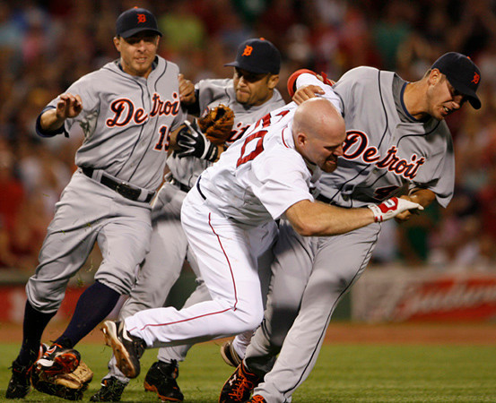 BOSTON, MA, Aug. 11, 2009: Detroit Tigers pitcher Rick Porcello (right) pulls Boston Red Sox batter Kevin Youkilis (second from right) down to the ground after Youkilis charged him as a result of being hit with a pitch in the second inning. Tigers third baseman Brandon Inge and second baseman Carlos Guillen are at left. (Brita Meng Outzen/Boston Red Sox)