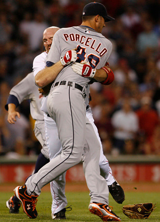 BOSTON, MA, Aug. 11, 2009: Boston Red Sox batter Kevin Youkilis (center) tackles Detroit Tigers pitcher Rick Porcello (right) after being hit with a pitch in the second inning. (Brita Meng Outzen/Boston Red Sox)
