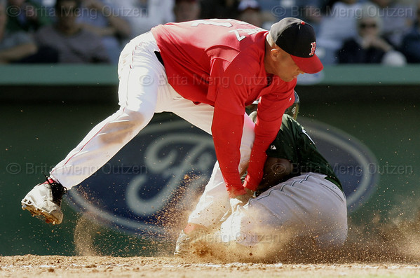 March 27, 2006, Fort Myers, Fla.: Tampa Bay Devil Rays base runner Joey Gathright, right, slides into Boston Red Sox pitcher Julian Tavarez, top, while trying to score on a hit by Julio Lugo in the eighth inning of their spring training baseball game. The play set off a fight, where both benches cleared after the incident. (AP Photo/Brita Meng Outzen)