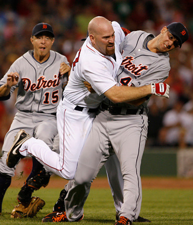 BOSTON, MA, Aug. 11, 2009: Detroit Tigers pitcher Rick Porcello (right) pulls Boston Red Sox batter Kevin Youkilis (second from right) down to the ground after Youkilis charged him as a result of being hit with a pitch in the second inning. Tigers third baseman Brandon Inge is at left. (Brita Meng Outzen/Boston Red Sox)