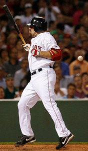 BOSTON, MA, Aug. 11, 2009: Boston Red Sox batter Kevin Youkilis is hit with a baseball thrown by Detroit Tigers pitcher Chris Porcello in the second inning. (Brita Meng Outzen/Boston Red Sox)
