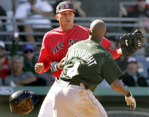 Boston Red Sox pitcher Julian Tavarez, left, fights with Tampa Bay Devil Rays base runner Joey Gathright after he slid into Tavarez while trying to score on a hit by Julio Lugo in the eighth inning of their spring training baseball game in Fort Myers, Fla., Monday March 27, 2006.  Both benches cleared after the incident. (AP Photo/Brita Meng Outzen)