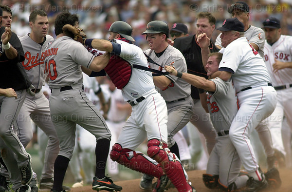 July 28, 2002, Boston, MA: Boston Red Sox pitching coach Tony Cloninger, third from right, has a chokehold on Baltimore Orioles catcher Brook Fordyce, fourth from right, as Fordyce holds Red Sox catcher Jason Varitek, fourth from left, back from Orioles left fielder Marty Cordova, third from left, during a bench-clearing brawl in the fourth inning at Fenway Park. (AP Photo/Brita Meng Outzen)