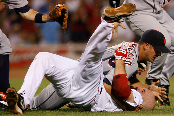 BOSTON, MA, Aug. 11, 2009: Detroit Tigers pitcher Rick Porcello (top) pulls Boston Red Sox batter Kevin Youkilis to the ground after being charged by Youkilis after hitting him with a pitch in the second inning. (Brita Meng Outzen/Boston Red Sox)