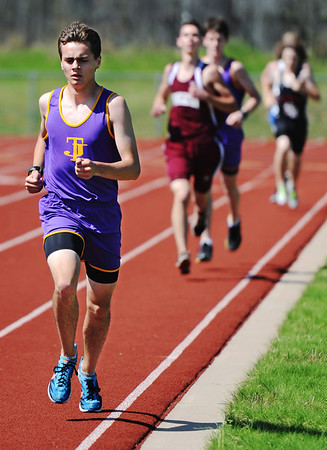 Globe/T. Rob Brown<br /> Thomas Jefferson's Chris Saladin leads the pack during the mile Tuesday afternoon, April 30, 2013, at Thomas Jefferson's field.