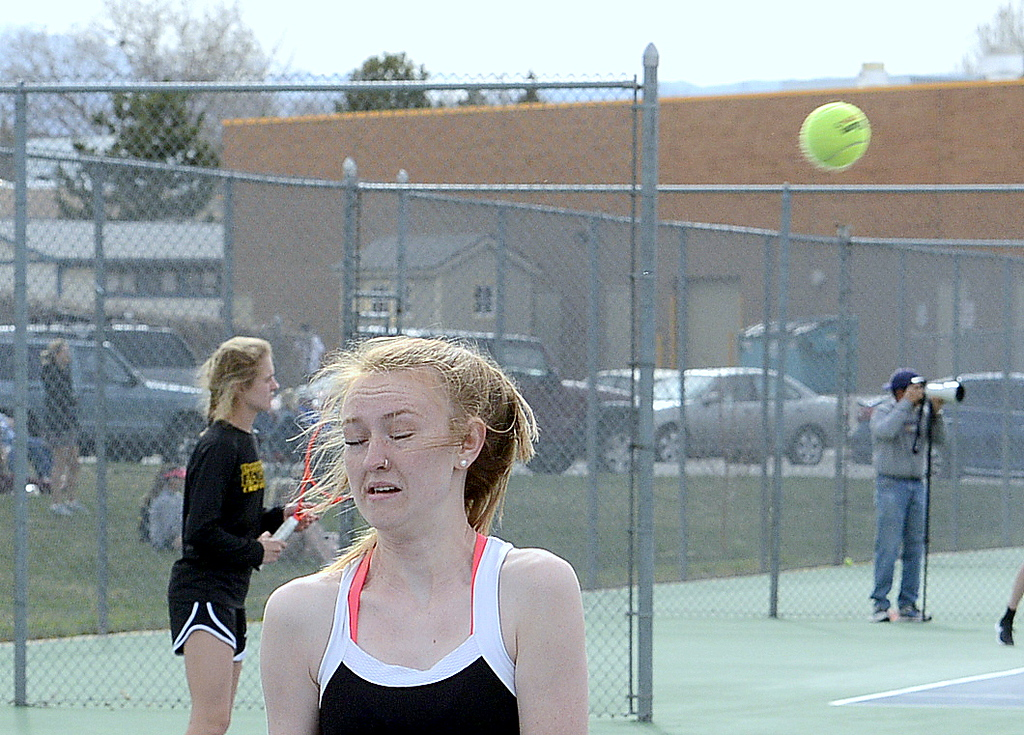 . Mountain View\'s Rylynn Neally was a bit shocked to see the return of her partner Taylor Mills whip by her head during their No. 3 doubles match Thursday at Thompson Valley. (Mike Brohard/Loveland Reporter-Herald)