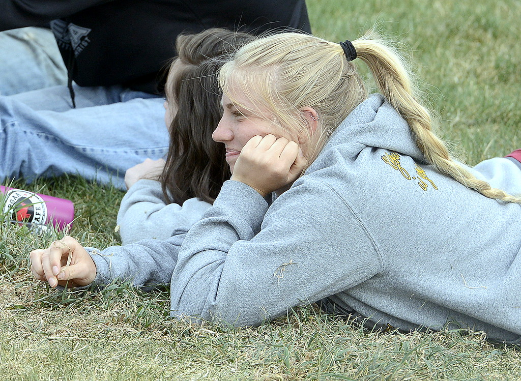 . Thompson Valley team captain and No. 1 singles player Maddie Sheets watches her team play against Mountaiin  View on Thursday. Sheets was forced into a spectator\'s role for her final home match when she drew a forfeit. (Mike Brohard/Loveland Reporter-Herald)