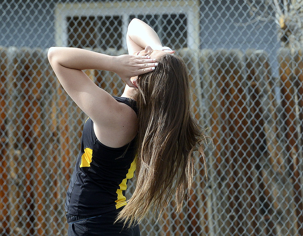 . Thompson Valley\'s Kaelyn Giefer adjusts her ponytail during a break in the action of Thursday\'s crosstown match with Mountain View. (Mike Brohard/Loveland Reporter-Herald)