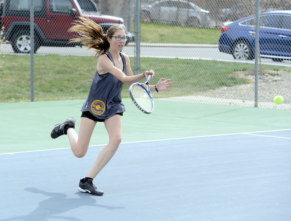 . Thompson Valley\'s No. 2 singles player Kylie Jacobson comes in for the return in her match against Mountain View\'s Audra Axline in Thursday\'s crosstown dual at the TVHS courts. (Mike Brohard/Loveland Reporter-Herald)