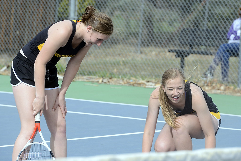 . Thompson Valley\'s No. 4 doubles tandem of Autumn Porter (left) and Sydney Laws can only laugh after a ball sailed between them after both of them said they had it during Thursday\'s match against Mountain View. (Mike Brohard/Loveland Reporter-Herald)