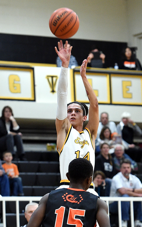 . Thompson Valley\'s #14 Julian Espinoza goes up for a three-pointer during their game against Greeley Central on Friday, Jan. 20, 2017, at Thompson Valley High School in Loveland. (Photo by Jenny Sparks/Loveland Reporter-Herald)