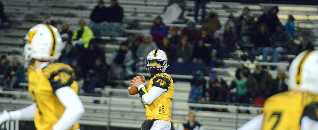 . Thompson Valley quarterback Cam Nellor eyes his target during Thursday\'s game with Roosevelt at Patterson Stadium. (Mike Brohard/Loveland Reporter-Herald)