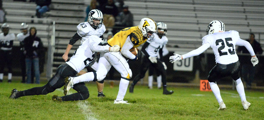. Thompson Valley receiver James Dyken is brought down by Roosevelt\'s Giovanni Lara after picking up a first down during Thursday\'s game  at Patterson Stadium. (Mike Brohard/Loveland Reporter-Herald)