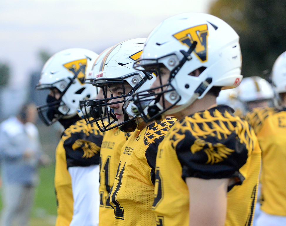 . Thompson Valley\'s captains wait on the sidelines in anticipation of the coin flip for Thursday\'s game with Roosevelt at Patterson Stadium. (Mike Brohard/Loveland Reporter-Herald)