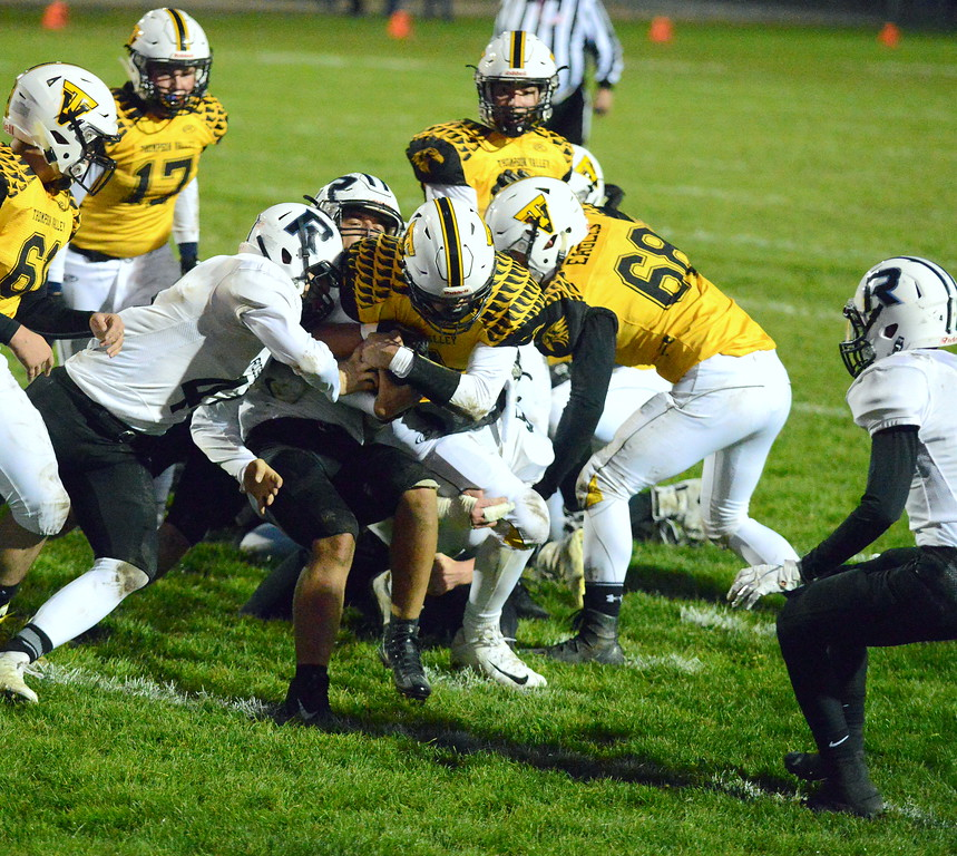 . Thompson Valley quarterback Cam Nellor drives to pick up a first down short of the goal line in the first quarter of Thusday\'s game with Roosevelt at Patterson Stadium. Nellor scored on the next play. (Mike Brohard/Loveland Reporter-Herald)