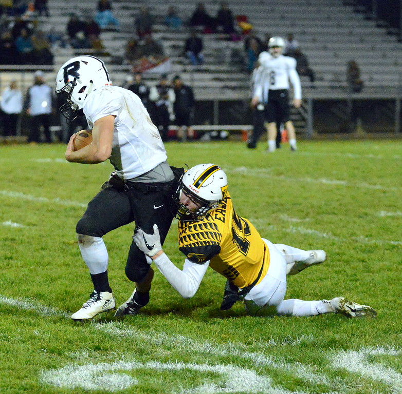 . Thompson Valley\'s Trey Kreikemeier comes up to make the stop on Roosevelt running back Nick Wall during Thursday\'s game  at Patterson Stadium. (Mike Brohard/Loveland Reporter-Herald)