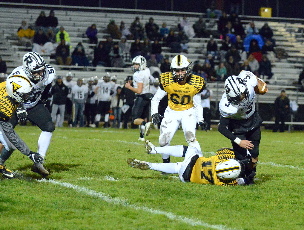 . Thompson Valley\'s James Dyken brings down Roosevelt running back Devynn Sanchez during Thursday\'s game  at Patterson Stadium. (Mike Brohard/Loveland Reporter-Herald)