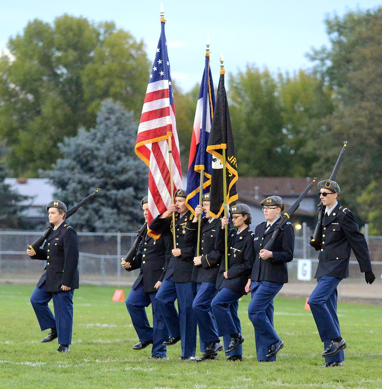 . Members of the Thompson Valley ROTC present the colors for the National Anthem for Thursday\'s game with Roosevelt at Patterson Stadium. (Mike Brohard/Loveland Reporter-Herald)