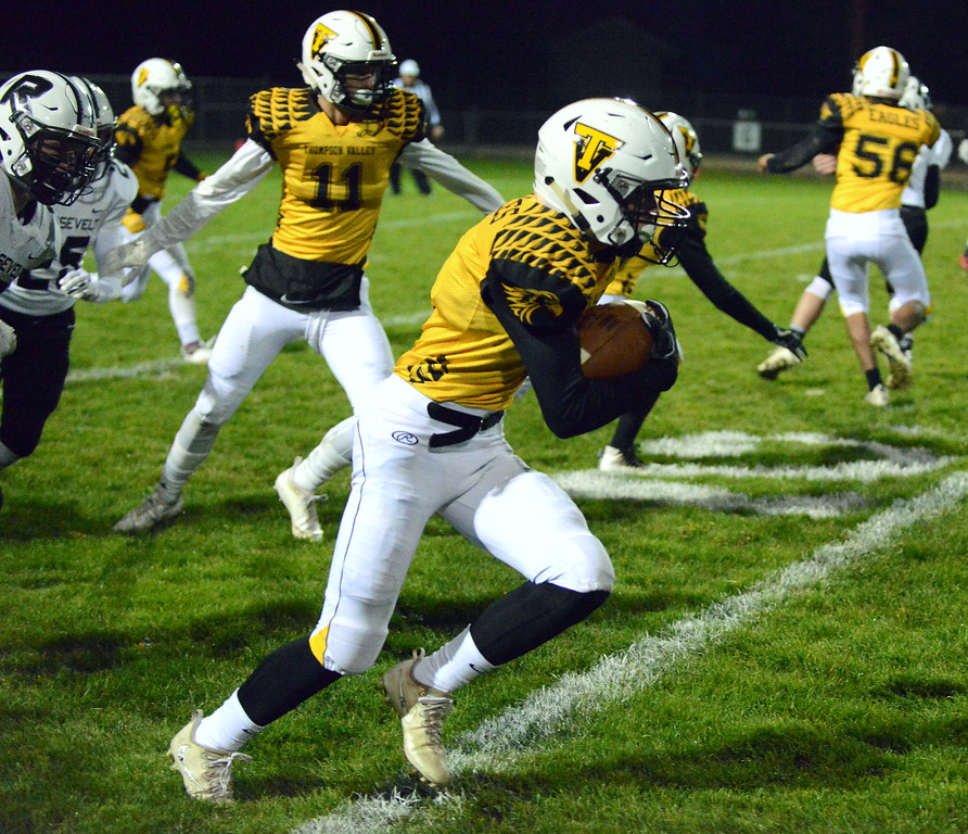 . Thompson Valley\'s Landon Carlson heads up the home sidelines on a kickoff return during Thursday\'s game  at Patterson Stadium. (Mike Brohard/Loveland Reporter-Herald)