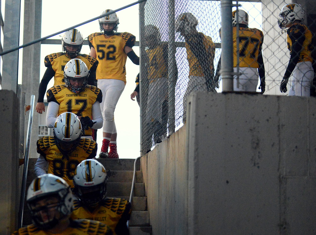. Thompson Valley\'s football team comes out of the locker room prior to the start of Thursday\'s game with Roosevelt at Patterson Stadium. (Mike Brohard/Loveland Reporter-Herald)