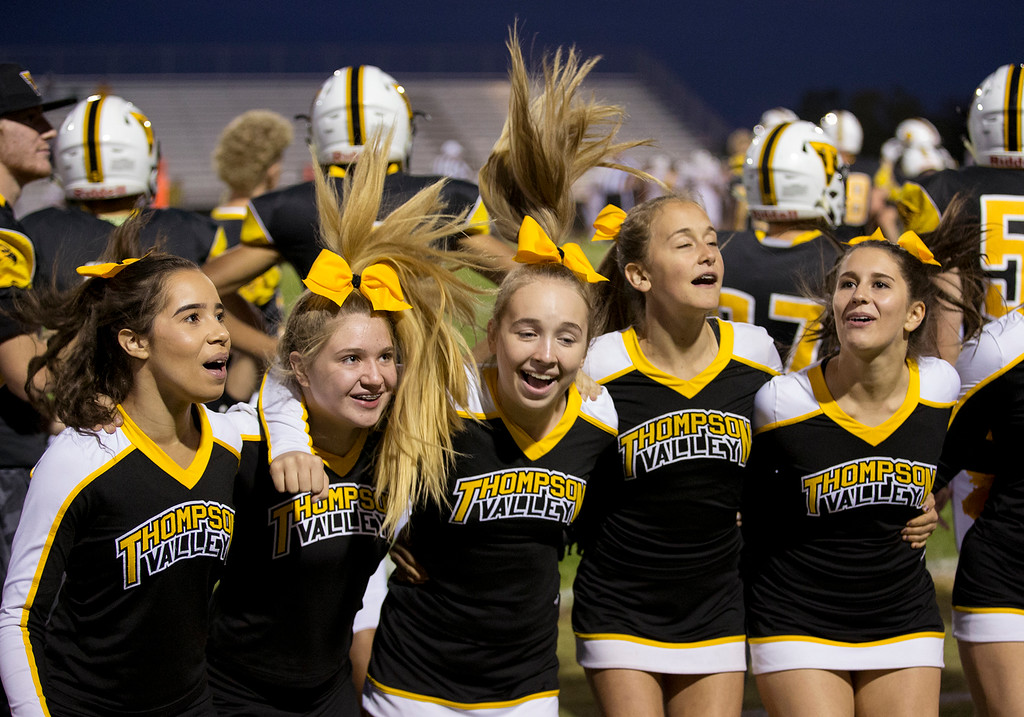 . Thompson Valley cheerleaders get the home crown fired up as their team faces Thomas Jefferson Thursday evening Sept., 27, 2018 at Patterson Field in Loveland. (Michael Brian/For the Reporter-Herald)