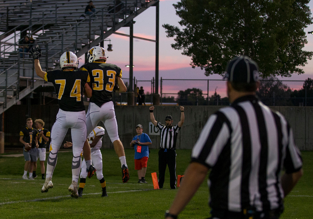 . Thompson Valley football players celebrate a touchdown against Thomas Jefferson as the sun sets Thursday evening Sept., 27, 2018 at Patterson Field in Loveland. (Michael Brian/For the Reporter-Herald)