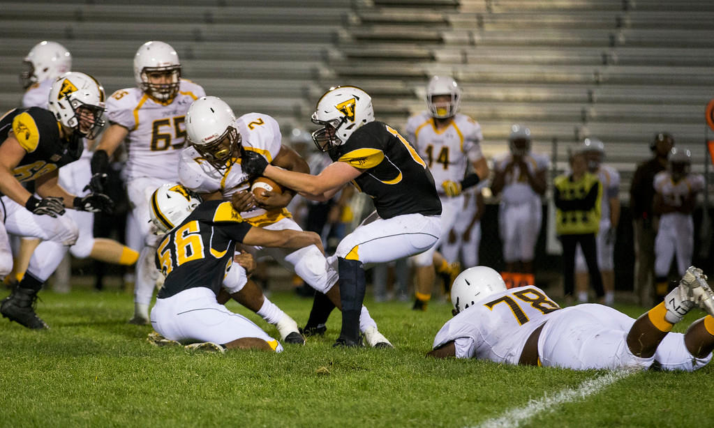 . Thompson Valley defenders Adam Behn (56) and James Dyken (17) bring down Thomas Jefferson\'s Daveon Hunter (2) Thursday evening Sept., 27, 2018 at Patterson Field in Loveland. (Michael Brian/For the Reporter-Herald)