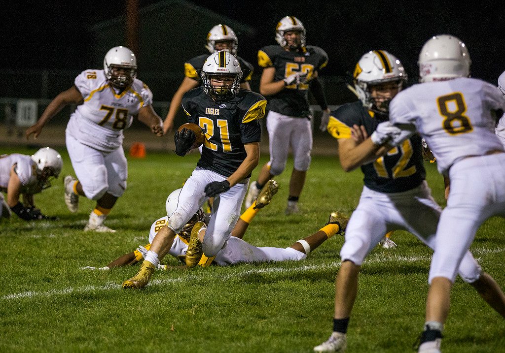 . Thompson Valley running back Aden Schaffer (21) gets away from a Thomas Jefferson tackle Thursday evening Sept., 27, 2018 at Patterson Field in Loveland. (Michael Brian/For the Reporter-Herald)
