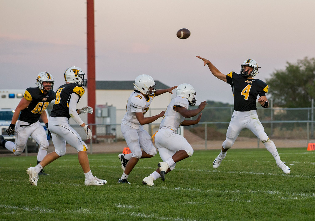 . Thompson Valley quarterback Cam Nellor (4) throws against Thomas Jefferson Thursday evening Sept., 27, 2018 at Patterson Field in Loveland. (Michael Brian/For the Reporter-Herald)
