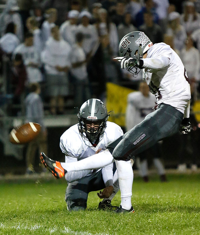 . Berthoud�s Ryan Schmad (81) kicks a field goal as Brock Voth (12) holds the ball steady on Thursday, Sept. 28, 2017, at Patterson Field. (Photo by Lauren Cordova/Loveland Reporter-Herald)