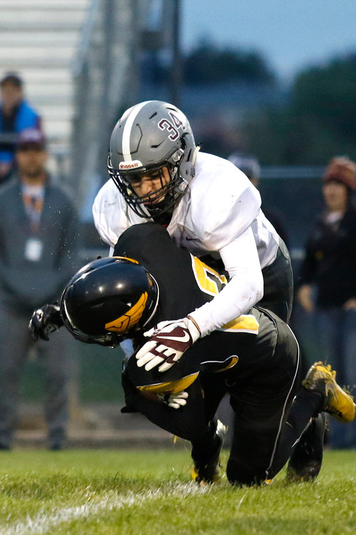 . Berthoud�s Jett Glasser (34) tackles Thompson Valley�s Kobi Turner (12) at the 20-yard line on Thursday, Sept. 28, 2017, at Patterson Field. (Photo by Lauren Cordova/Loveland Reporter-Herald)
